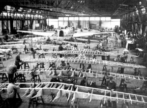 Fokker factory in 1936. Wings of the D.21 fighter in the front and the large fusulage of a T.5 bomber in the back of the hangar